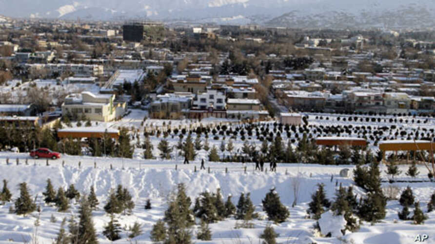 People walk up the hillside after a snow storm in Kabul, Afghanistan, Feb. 4, 2012.