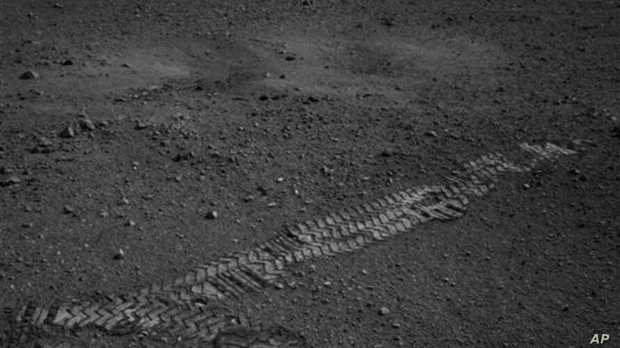 This NASA image shows the Curiosity rover's wheel tracks on the surface of Mars, from an image sent from one of the rover's cameras, August 22, 2012.