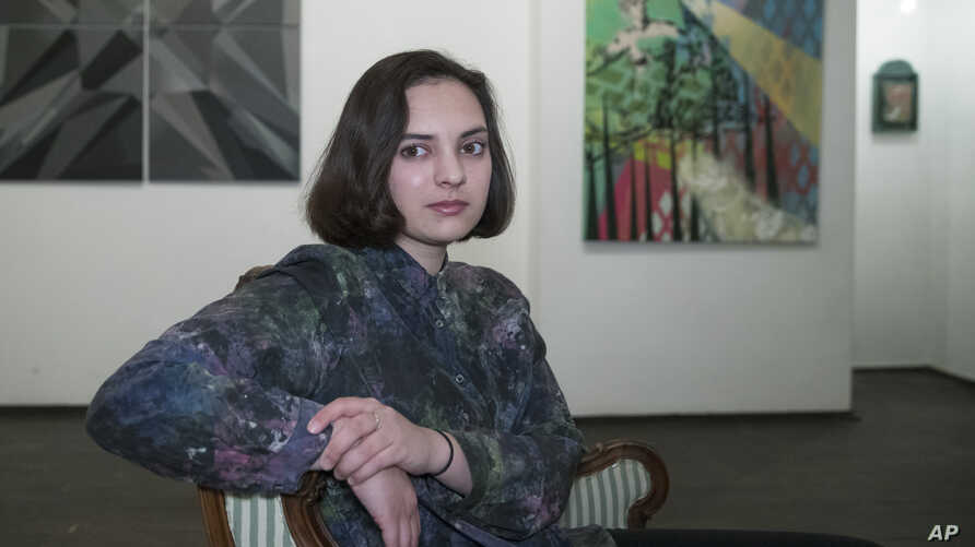 "Art-curator Maria Pogodina poses for a photo in Moscow, Russia, March 3, 2018. When she looks at the current state of affairs in Russia today, Maria feels like she's living in a ""surreal"" reality, with ""absurd"" news flashes, blocked domain names and"