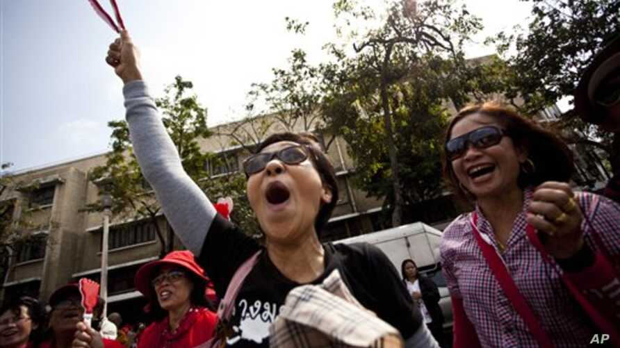 Thai anti-government protestors march at a Red Shirt protest rally  in Bangkok, Thailand, February 19, 2011