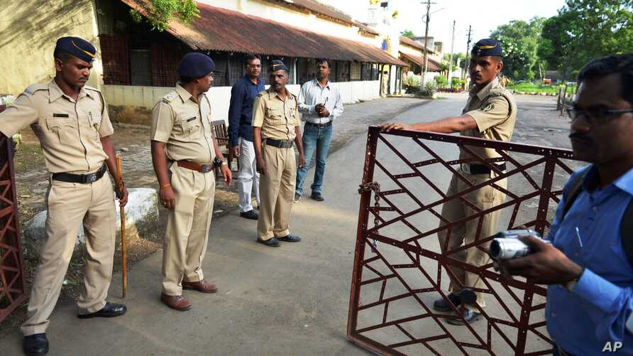 Indian policemen guard outside the Nagpur Central Prison where the 1993 Mumbai blasts convict Yakub Abdul Razak Memon, is currently held in Nagpur, India, Wednesday, July 29, 2015.