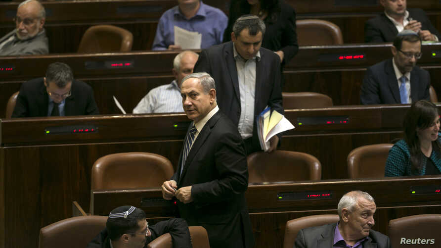 Israel's Prime Minister Benjamin Netanyahu leaves after a vote to dissolve the Israeli parliament, also known as the Knesset, in Jerusalem, Dec. 8, 2014.