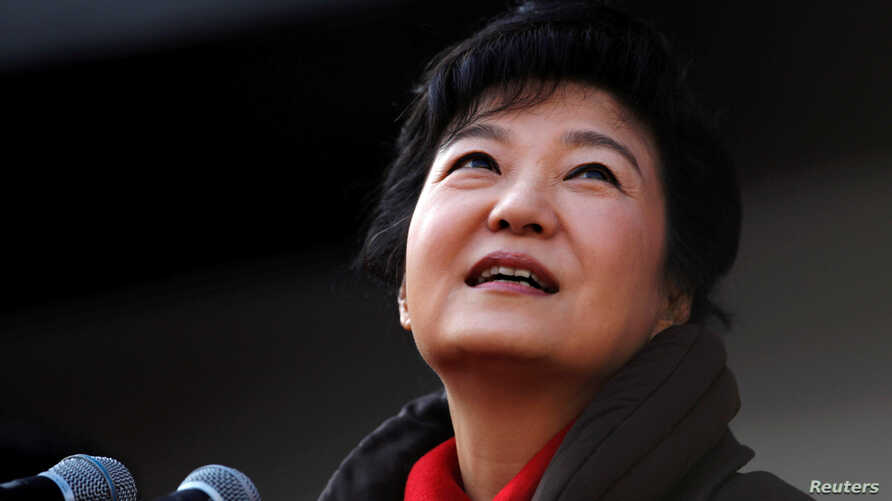 FILE - South Korea's presidential candidate Park Geun-hye of the ruling Saenuri Party attends her election campaign rally in Suwon, about 46 km (29 miles) south of Seoul, Dec. 17, 2012.