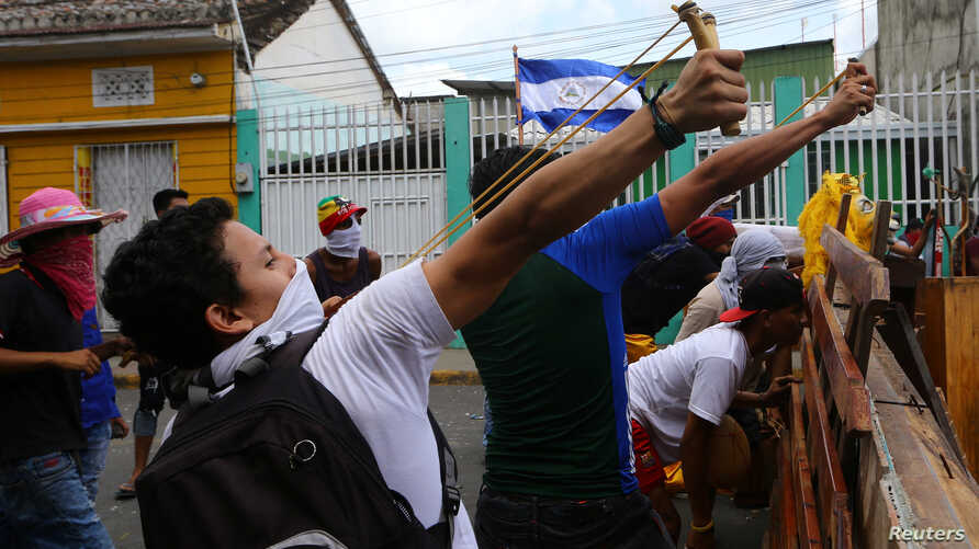 Demonstrators clash with riot police during a protest against Nicaragua's President Daniel Ortega's government in Masaya, Nicaragua, June 2, 2018.