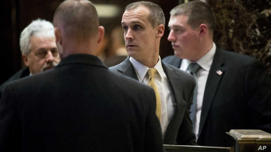 Corey Lewandowski (center) former campaign manager for President-elect Donald Trump, walks in the lobby of Trump Tower in New York, Dec. 7, 2016.