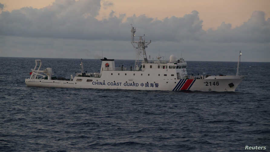 China Coast Guard vessel No. 2146 sails in the East China Sea near the disputed isles known as Senkaku isles in Japan and Diaoyu islands in China, in this handout photo, Aug. 8, 2013.