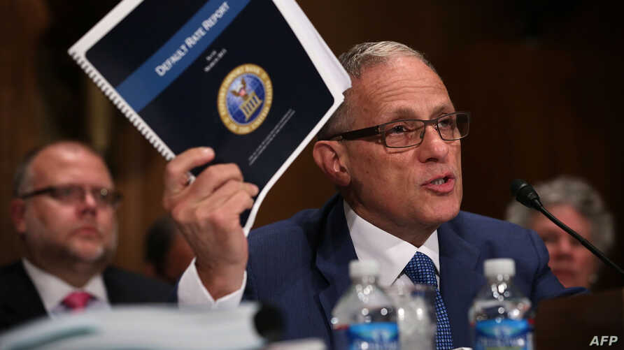 FILE - Fred Hochberg, Chairman and President of the Export-Import Bank of the United States holds up a copy of the bank's Default Rate Report as he testifies before a congressional committee June 4, 2015 on Capitol Hill in Washington, D.C.