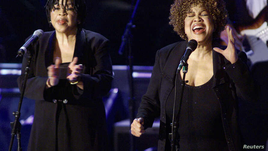 Mavis Staples (R) and Yvonne Staples (L) perform after they and the rest of the Staples Singers accepted their induction into the Rock & Roll Hall of Fame at the 14th Annual Rock and Roll Hall of Fame Induction Ceremony at New York's Waldorf Astoria