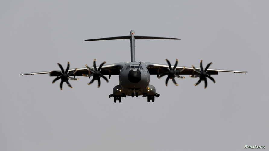 FILE - An Airbus A400M military plane flies before landing during a test flight at the airport of the Andalusian capital of Seville, May 12, 2015.