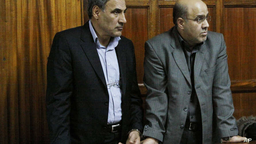 Iranian nationals Sayed Mansour Mousavi, left, and Ahmed Abolfathi Mohammed, right stand in the Nairobi magistrates court in Nairobi, Kenya, (File photo).