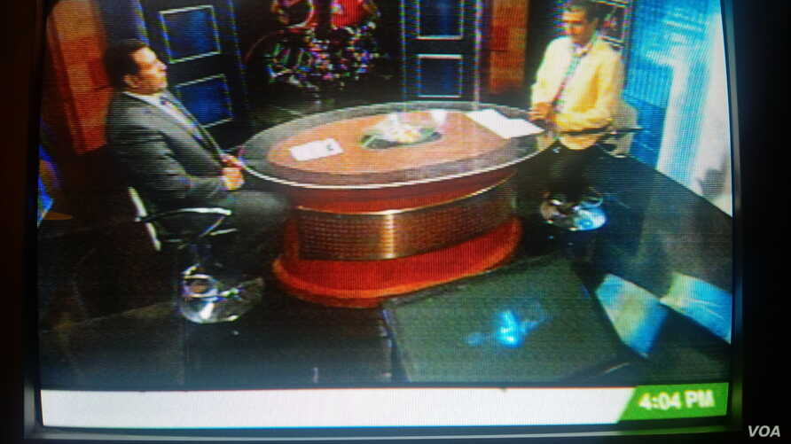 """Egyptian television displays the """"Egypt Fighting Terrorism"""" banner during a sports program, August 20, 2013."""