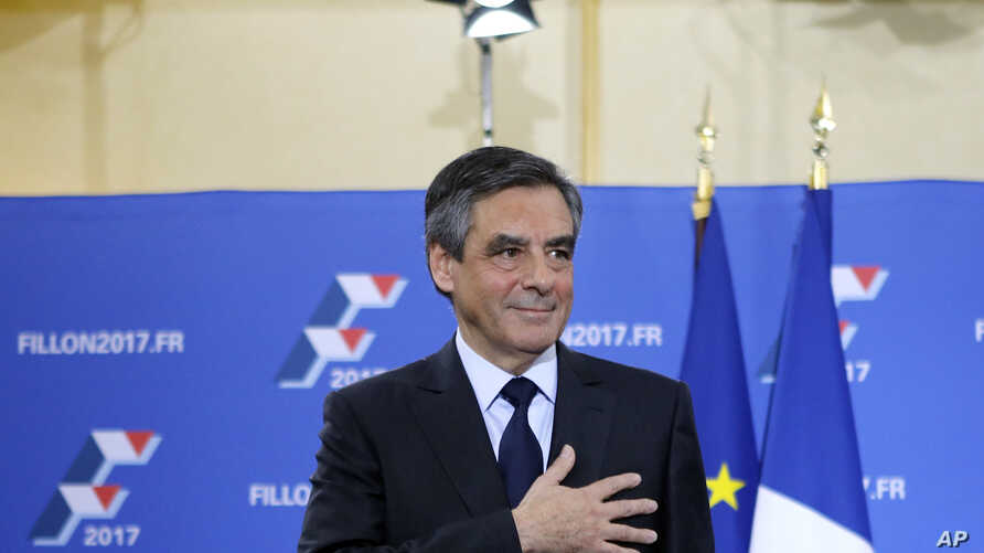 Francois Fillon puts his hand on his heart after delivering a speech following the conservative presidential primary, in Paris, France, Nov. 27, 2016.