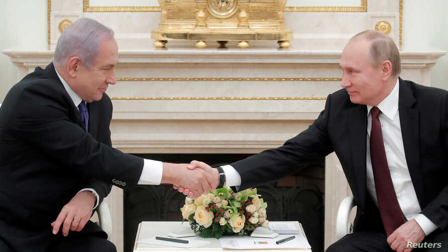Russian President Vladimir Putin, right, shakes hands with Israeli Prime Minister Benjamin Netanyahu during a meeting at the Kremlin in Moscow, Russia, Feb. 27, 2019.