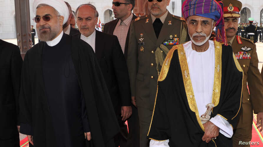 Oman's Sultan Qaboos bin Said (R) walks with Iran's President Hassan Rouhani upon Rouhani's arrival in Muscat, Oman, March 12, 2014.