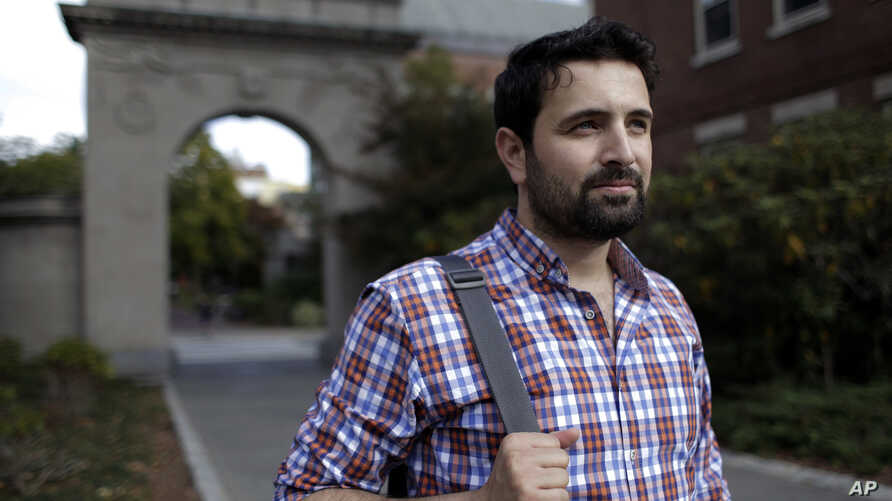 FILE - Khaled Almilaji is studying for a master's degree in public health at Brown University in Providence, R.I., Oct. 13, 2016. Almilaji is stuck in Turkey because President Donald Trump's executive order does not permit him to return to Providence