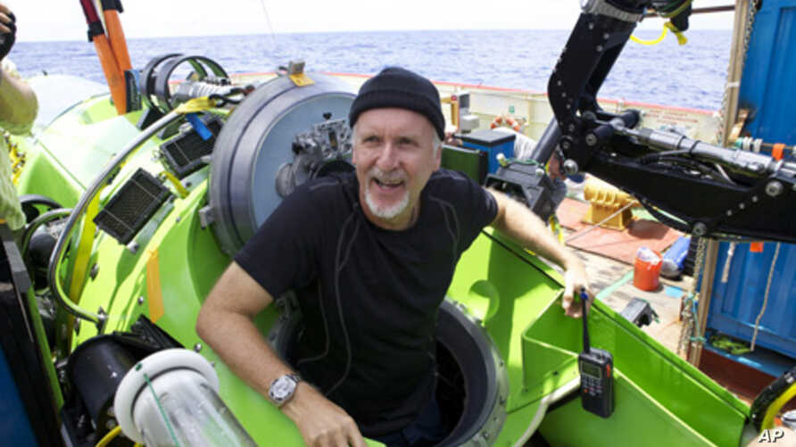 Filmmaker James Cameron emerges from the Deepsea Challenger after his successful solo dive to the Mariana Trench, the deepest part of the ocean. The dive was part of the Deepsea Challenge, a joint effort with the National Geographic Society and Rolex