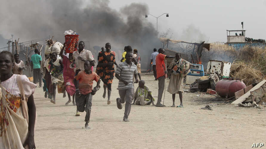 South Sudanese civilians flee fighting in an United Nations base in the northeastern town of Malakal on February 18, 2016, where gunmen opened fire on civilians sheltering inside killing at least five people.