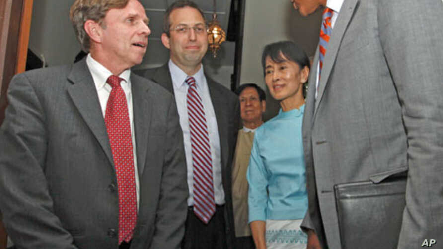 Burma's pro-democracy leader Aung San Suu Kyi meets with the new U.S. special envoy to Myanmar Derek Mitchell (C) and U.S. Assistant Secretary of State for Democracy Human Rights and Labor Michael Posner (L) at her home in Yangon, Burma, November 4,
