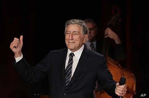 "Tony Bennett gestures after singing ""I Left My Heart in San Francisco"" during a sound check for a Valentine's Day benefit concert in the Venetian Room at the Fairmont Hotel in San Francisco. Bennett returned the hotel to celebrate the 50th anniversar..."