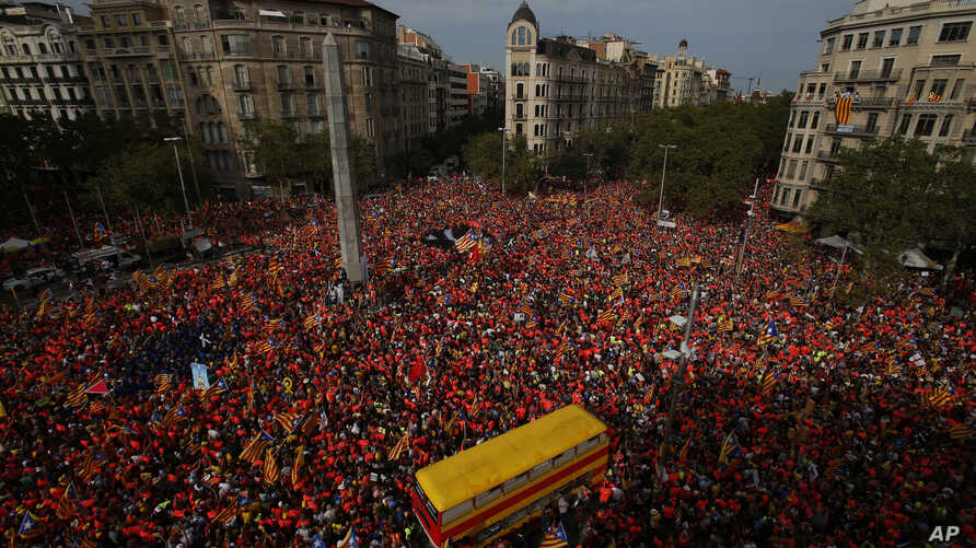 Pro-Independence demonstrators pack the Avenida Diagonal during the Catalan National Day in Barcelona, Spain, Sept. 11, 2018.