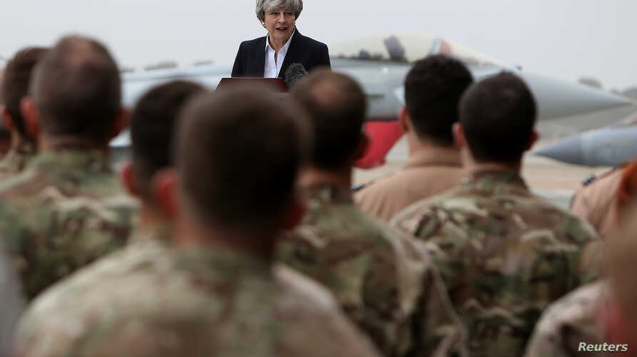 Britain's Prime Minister Theresa May speaks to the troops at RAF Akrotiri, one of two military bases Britain maintains on the east Mediterranean island of Cyprus, Dec. 22, 2017.