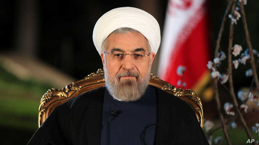 In this photo released by the official website of the Iranian Presidency office on Thursday, March 20, 2014, Iranian President Hassan Rouhani delivers a message for the Iranian New Year, or Nowruz, in Tehran, Iran