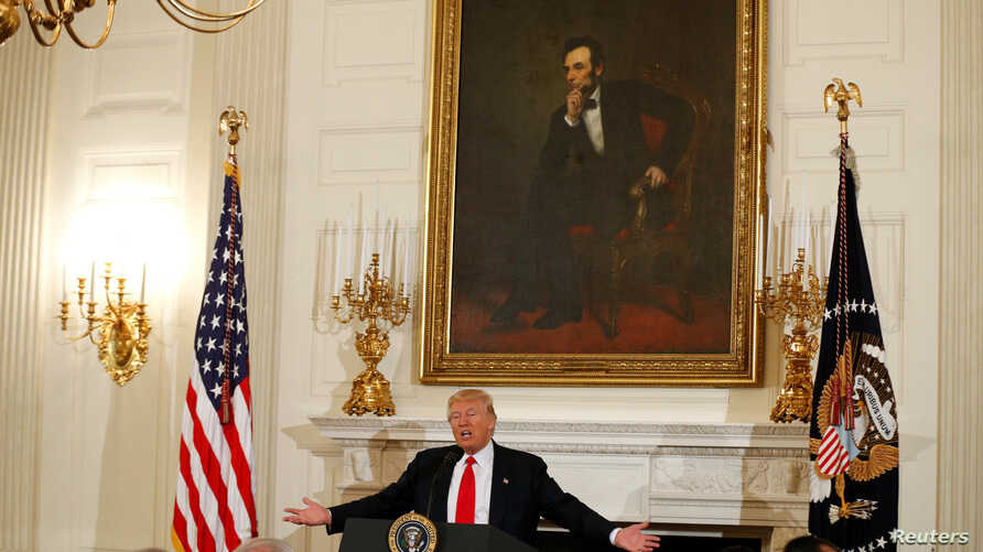 Under a painting of President Abraham Lincoln, U.S. President Donald Trump speaks during a National Governors Association meeting at the White House in Washington, Feb. 27, 2017.
