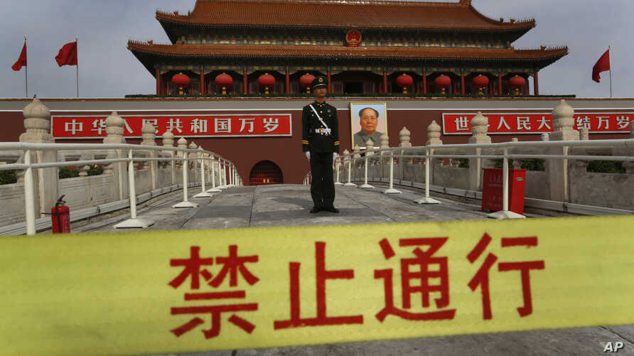 A Chinese paramilitary policeman stands guard in front of  Tiananmen gate in Beijing, China, Nov. 7, 2012.