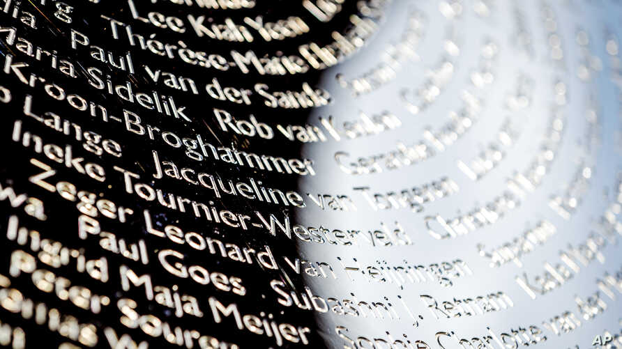 FILE - Names of the victims during the revealing of the National Monument for the MH17 in Vijfhuizen, The Netherlands, July 17, 2017.