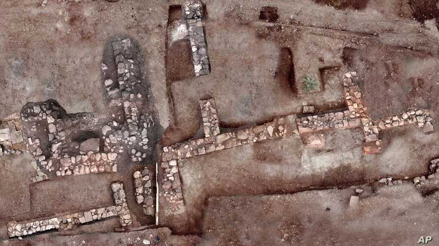 This undated photo provided by the Greek Ministry of Culture on Nov. 13, 2018, shows remains of walls and floors, probably from houses, from the lost ancient city of Tenea.