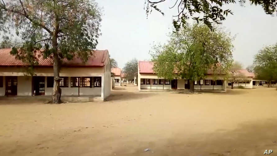 This image taken from video shows the exterior of Government Girls Science and Tech College in Dapchi, Yobe State, Nigeria, Feb. 22, 2018.