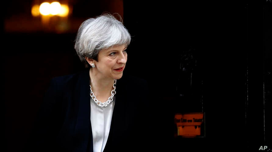 Britain's Prime Minister Theresa May walks to welcome Ukraine's President Petro Poroshenko prior to their talks, at 10 Downing Street in London, April 19, 2017.