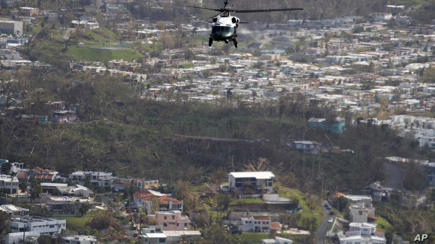 Marine One helicopter carrying President Donald Trump surveys areas impacted by Hurricane Maria, Oct. 3, 2017, near San Juan, Puerto Rico.