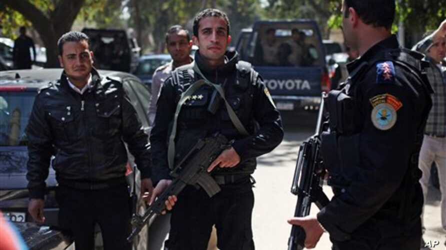 Egyptian police officers take positions during the arrest of Ahmed Qaddaf al-Dam, Cairo, March 19. 2013.