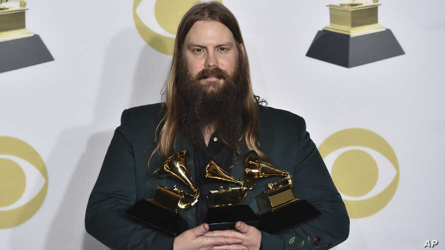 """Chris Stapleton poses in the press room with his awards for best country solo performance for """"Either Way"""", best country song for """"Broken Halos"""" and best country album for """"From a Room: Volume 1"""" at the 60th annual Grammy Awards at Madison Square Gar"""