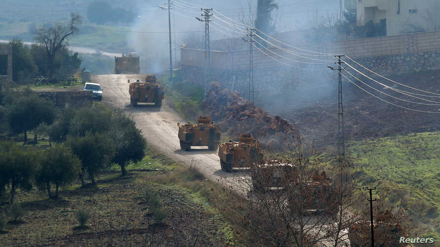 Turkish military armoured vehicles arrive at a border village near the town of Hassa in Hatay province, Turkey, Turkey Jan. 21, 2018.