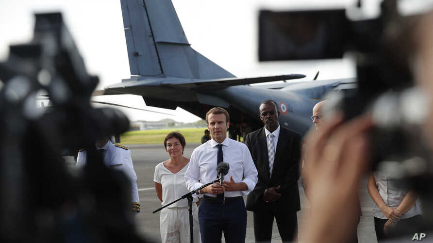 France's President Emmanuel Macron addresses the media upon his arrival in Pointe-a-Pitre, Guadeloupe island, the first leg of his trip to French Caribbean islands, Sept. 12, 2017.