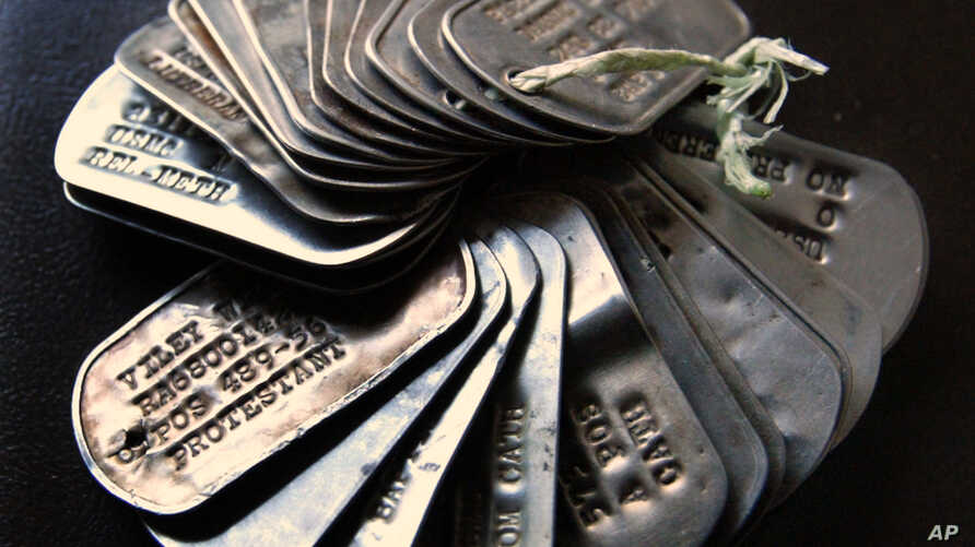 FILE - US military dog tags are on display as part of a private collection in Wheaton, Ill.