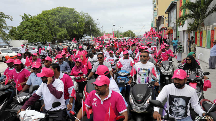Supporters of Maldivian President Abdulla Yameen ride on their bikes during the final campaign march rally ahead of the presidential election in Male, Maldives, Sept. 22, 2018.
