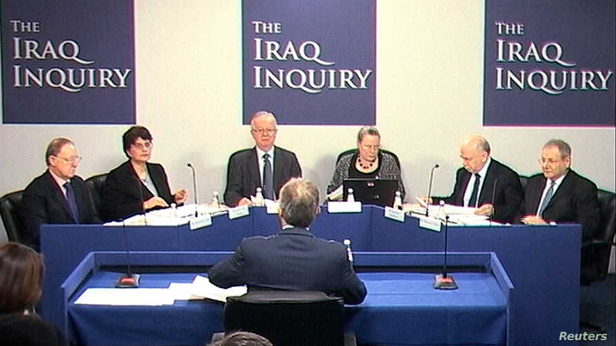 LE - A still image from video shows former British Prime Minister Tony Blair (back to camera) speaking at an inquiry into Britain's role in the Iraq War in central London, Jan. 21, 2011.