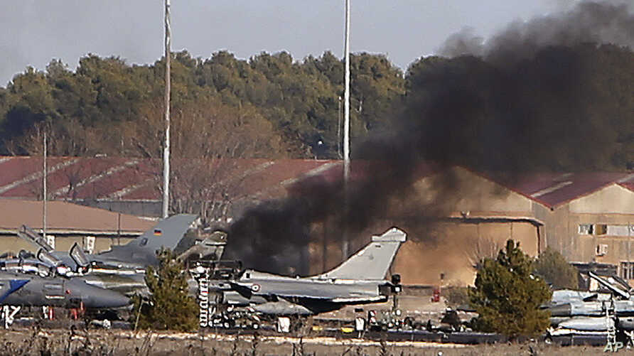 Smoke rises from a military base after a plane crash in Albacete, Spain, Jan. 26, 2015.