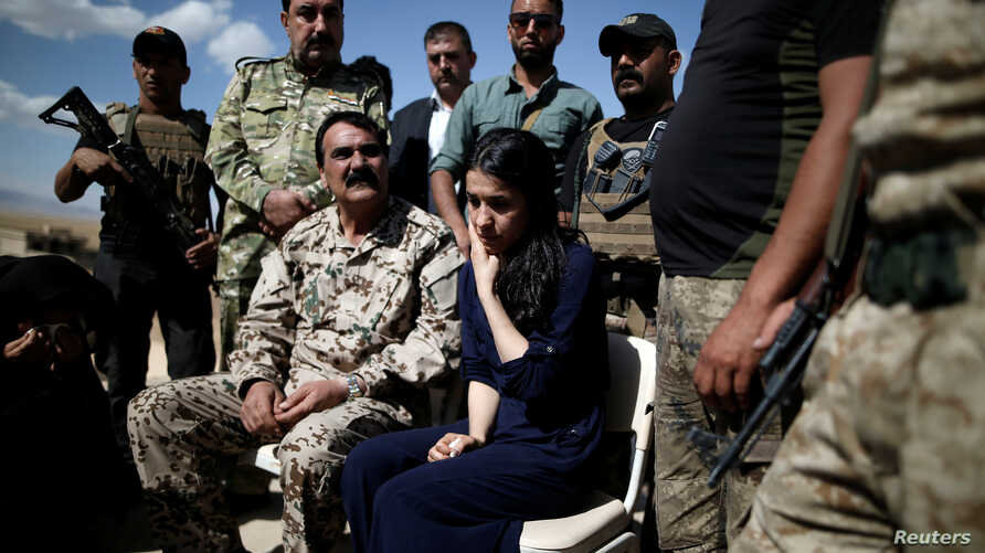 Yazidi survivor and U.N. Goodwill Ambassador for the Dignity of Survivors of Human trafficking Nadia Murad, center, visits her village for the first time after being captured and sold as a slave by the Islamic State three years ago, in Kojo, Iraq, Ju