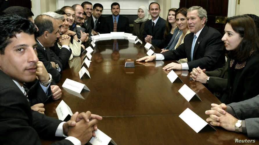 U.S. President George W. Bush meets with Iraqi Fulbright Scholars, the first to come to the United States since 1990, in the Roosevelt Room of the White House in Washington, Feb. 3, 2004.