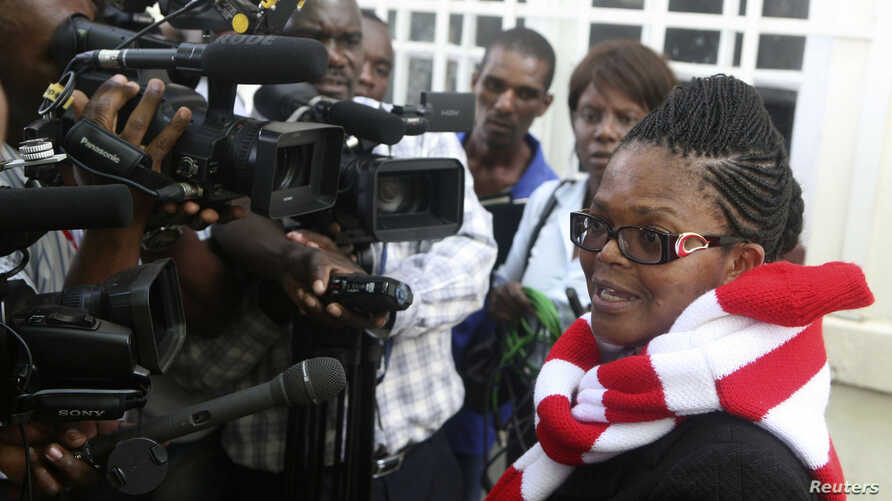 Zimbabwe's Lawyers For Human Rights (ZLHR) Board Member Beatrice Mtetwa speaks to the media outside the High Court after she was granted a $500 bail in Harare, March 25, 2013.