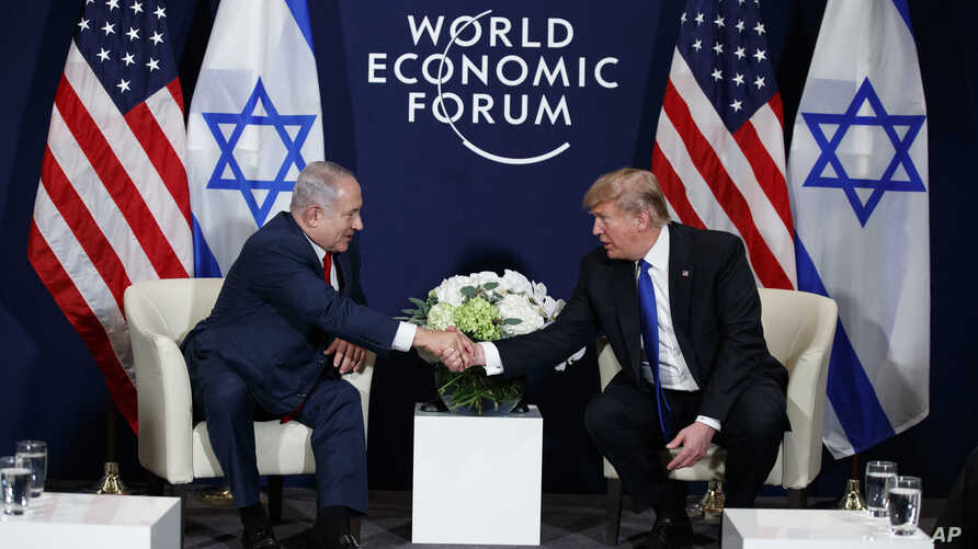 President Donald Trump shakes hands with Israeli Prime Minister Benjamin Netanyahu during a meeting at the World Economic Forum, Jan. 25, 2018, in Davos, Switzerland.