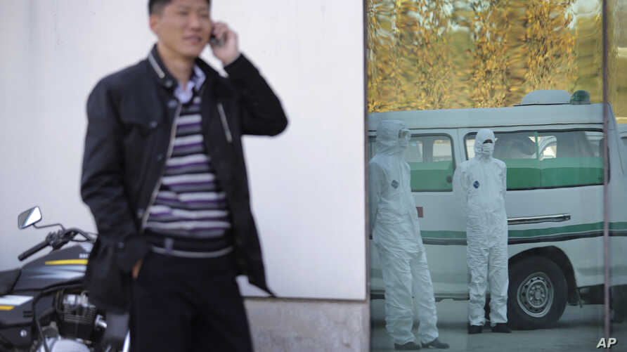 FILE - A North Korean man uses a mobile phone at the Sunan International Airport in Pyongyang, Oct. 27, 2014.