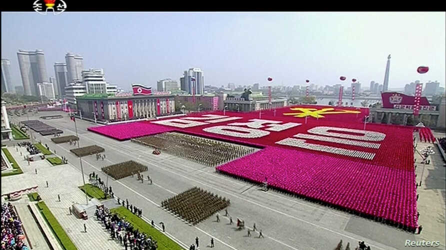 "FILE - A view of a military parade marking the 105th ""Day of the Sun,"" the birth anniversary of the state's founder Kim Il Sung, in Pyongyang, North Korea, in this still image taken from video released by North Korea's state-run television KRT, April"