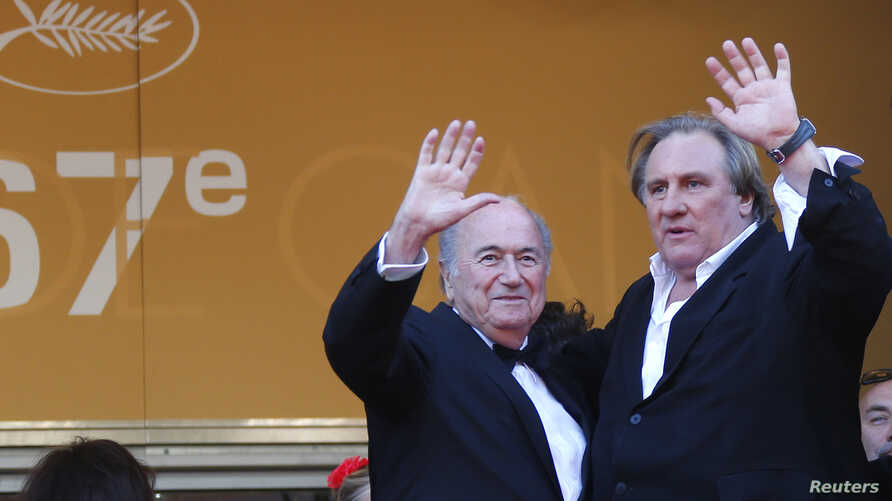 "FILE - Actor Gerard Depardieu (R) and then-FIFA President Sepp Blatter pose on the red carpet for the screening of the film ""United Passions"" at the 67th Cannes Film Festival in Cannes, May 18, 2014."