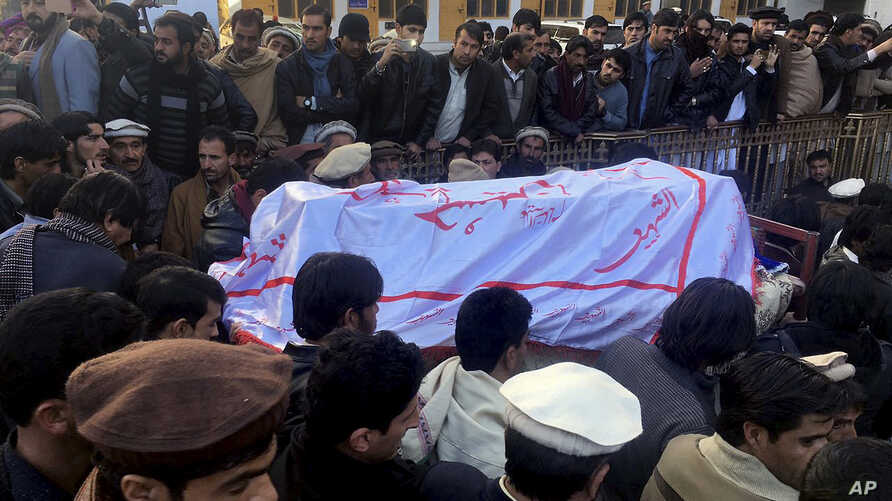 FILE - Pakistanis attend a funeral service for the victims of a bomb blast at a mosque in Parachinar, the capital of Pakistan's northwestern Kurram tribal region, Jan. 21, 2017.