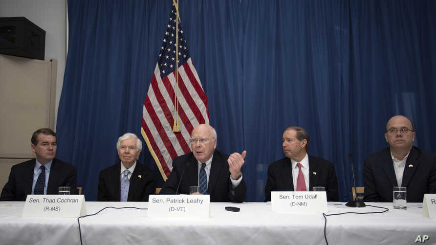 U.S. Senator Patrick Leahy of Vermont, center, speaks during a press conference alongside Senator Tom Udall of New Mexico, second from right, Senator Thad Cochran of Minnesota, second from left, Senator Michael Bennet of Colorado, far left and U.S. C